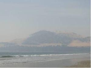 Bushfires create a hazy Seven Mile Beach, Hobart, Tasmania